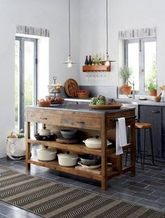 Kitchen island ideas for inspiration on creating your own dream kitchen. diy painted small kitchen design - with seating and lighting