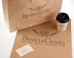 Photograph of carry bags and coffee cup for Bean and Grain. Design by Papercut Graphic Design, Canberra.