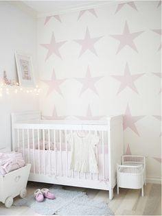 Love the idea to wallpaper one wall in my baby girls room