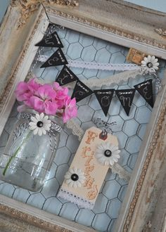 kerstie pederson  Wreath made from vintage frame, chicken wire, mason jar,chalkboard bunting, bakers twine.