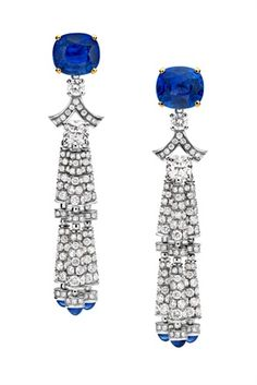 bulgari, love the little tips of blue dancing   around the neck with each turn.