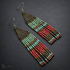 Beautiful multi colored earrings. Extra long beaded earrings. These earrings made with tiny japanese seed beads. Ear wires are surgical steel. Length -10 cm (4) (including ear wires). Width - 2 cm (0.8) More seed bead earrings from my shop you can see here: