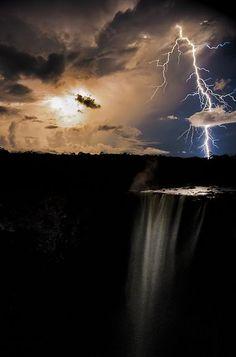 *James Broscombe caught the lightning illuminating the Guyana's Kaietuer Falls after dusk.