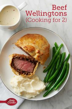 Beef Wellingtons (Cooking for Make an impressive dinner worthy of a fine dining restaurant, right at home and sized perfectly for two! Flaky pastry is wrapped around tender filet mignon and flavorful sautéed mushrooms. Making two individual portions not Meat Recipes, Dinner Recipes, Cooking Recipes, Uk Recipes, Dinner Menu, Drink Recipes, Salad Recipes, Recipies, Cooking For Two