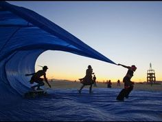 Catch a wave on the playa - Tarp Surfing at Burning Man.