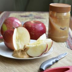 Late night snacks - An Apple with a Spoonful of Peanut Butter http://www.womenshealthmag.com/weight-loss/healthy-bedtime-snacks?slide=7
