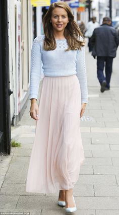 Pretty in pastels: Lydia looked ready for spring as she teamed her floaty pink skirt with a pale blue jumper and matching shoes