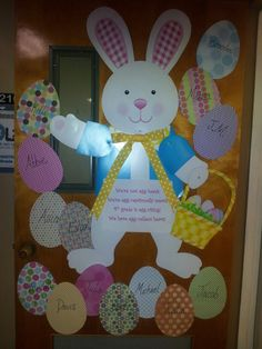 My April classroom door- I printed off an egg template online and traced onto coordinating scrapbook paper for student eggs- the rabbit was from Party City
