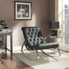 """Canoe Rocking Chair In Black - EEI-235-BLK $415  Description :  Paddle your way to serenity with the calming Canoo rocker. Perhaps the most noticeable aspect of the design is the dual-natured look to it. Whereas the honed chrome metal frame is sleek and discerning, the cushioned leatherette padding is the epitome of comfort. The piece is both minimalist and edgy, and lets you chart your course on to more refined living quarters.  Dimension :  Overall Product Dimensions : 25.5""""L x 33""""W x 40""""H…"""