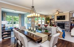 Transitional Dining Room with High ceiling, Crown molding, Chandelier, Hardwood floors