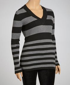 We love this sweater top for its simple silhouette. Cool colors and ribbing create a winning ensemble.Size Note:This item runs small. Poof! recommends ordering one size up.Measurements (size 1X): 28'' long from high point of shoulder to hem60% cotton / 35% rayon / 5% spandex