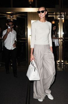 Karlie Kloss in Pooling Pants and a Fitted Sweater