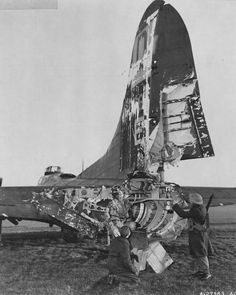 The B-17 was famous for her durability and survivability. Here one B-17 of the 100th Bomber Squadron of the USAAF rests in an English airfield after being severely damaged by flack over Frankfurt. She was eventually repaired and returned to normal duty, 1944.
