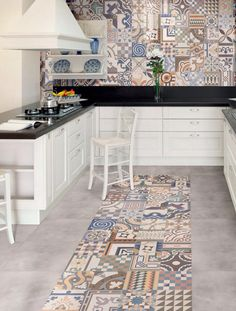 Shoreditch apartment posted by The Baked Tile Co. Colourful patterned Moroccan style encaustic baked tiles transitioning into what looks like concrete but may well be tiling! I love this look!