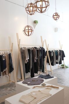 40 Easy And Practical Clothing Racks For Casual Décor Ideas - ZYHOMY I am finding my brown belt, but where is the black one? Has this ever happened to you? Diy Clothes Rack Wood, Wood Clothing Rack, Boutique Decor, Boutique Clothing, Casual Decor, Pinterest Diy, Shop Window Displays, Stores, Store Design