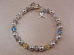Down Syndrome Sterling Silver Bracelet by KrisTsCreations on Etsy, $45.00