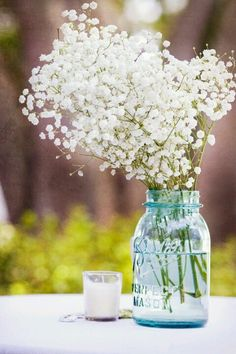 Baby's breath!! What about mostly baby's breath in your centerpieces? It's so soft and pretty
