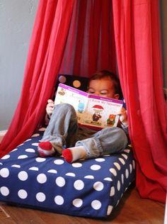 Turn a crib mattress into a reading nook.
