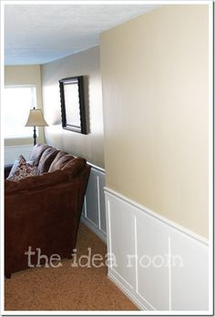 DIY wainscoting.....chair rail plus straight boards and paint in the wall in the middle....