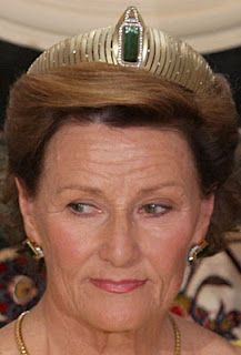 Modern Yellow Gold Tiara ( Queen Sonja of Norway) set with a green Tourmaline.
