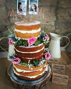Naked wedding cake - three different flavoured tiers decorated with wired flowers and succulents, copper wire 'Mrs and Mrs' and Polaroid photos of the brides. Absolutely delicious and huge compliments were received #nakedcake #weddingcake #loveislove #mrsandmrs #rustic #barnwedding #succulents