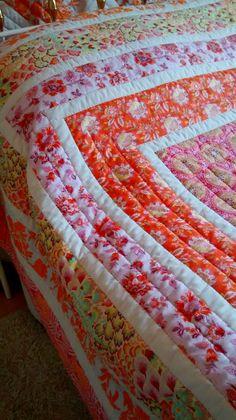 detail of pink and orange quilt