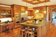 Like the cabinet color, not the style.  Love the island, but would change the granite color.  Warm feeling.