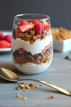 Granola Parfait layered with healthier granola (made with coconut oil!), dark chocolate pieces, Greek yogurt and berries - delicious! #healthy #diet