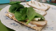 Slimming World Lunch.  Ryvita Crispbread topped with Total 0%, Black Pepper, Sweet Chilli Sauce, Turkey Slices, Baby Spring Onions and Spinach