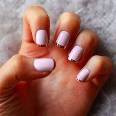 Brides.com: . A pink French manicure with gold tips.