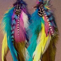 Yellow green pink aqua blue pheasant feather by MineOverMatter