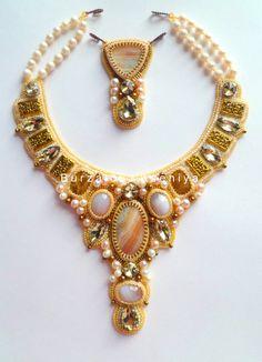 Ksenia Burzalova is russian beadwork artist. She makes beautiful embroidered jewelry,  every piece has pretty charm and deep beauty.