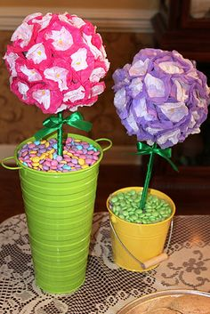 I made cute topiaries by covering floral foam with tissue paper. The base of the topiaries was filled with spring colored M and M's