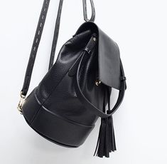 A combination of two of our favorite things - Bucket bags + backpacks.