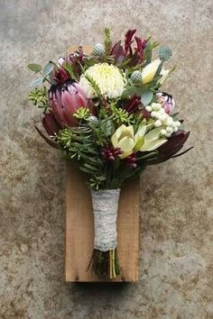 I like the deep pink protea with the white and dark green. spring bouquet using natives - white waratah, proteas, leucadendrons, eucalyptus buds, kangaroo paw and berzelia Spring Wedding Flowers, Rustic Wedding Flowers, Wedding Flower Arrangements, Bridal Flowers, Flower Bouquet Wedding, Floral Wedding, Floral Arrangements, Bouquet Flowers, Boutonniere