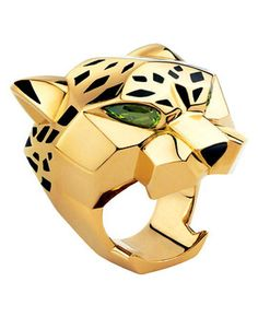 Cartier Panthère Ring  Introduced in 1914, the motif, was inspired by Louis Cartier's fellow jeweler Jeanne Toussaint, who was nicknamed the Panther.  Since then most probably, this Panther would have appeared in many forms as Brooch, Ring, pedant, Fountain Pens, Cuff Links...etc