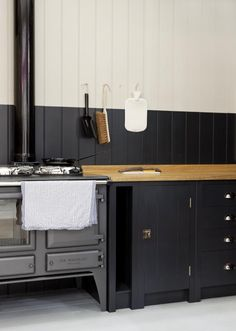 A Kitchen for the People, Courtesy of Prince Charles - Remodelista Plain-English-British-Standard-Kitchen comes with iroko,oak or sycamore wood worktop surface Home Design, Küchen Design, Design Ideas, Kitchen Maker, Kitchen Stove, Aga Stove, Black Kitchens, Home Kitchens, Kitchen Black