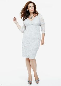 Make a grand entrance with style and grace in this magnificent stretch lace dress!  3/4 sleeve beaded stretch lace dress with ultra-feminine v-neckline.  Crisscross front adds texture and dimension to thisflawless ensemble.  Fully lined. Imported polyester/spandex blend. Hand wash cold inside out, do not bleach.