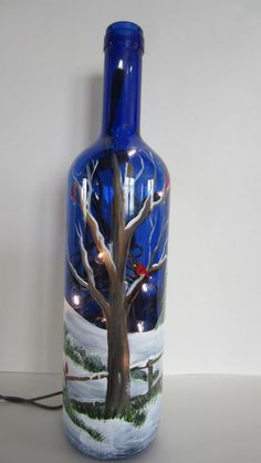 Cobalt Bottle With Winter Tree , Fence and Cardinals Lighted Wine Bottle Decorated Liquor Bottles, Painted Wine Bottles, Lighted Wine Bottles, Painted Wine Glasses, Bottle Lights, Wine Bottle Glasses, Wine Bottle Art, Christmas Wine Bottles, Glass Bottle Crafts