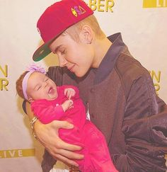 Aww he's so cute with babies.