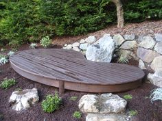 Meditation platform and sitting rock. Templates, made in the design phase, ensured that the shop-built deck would fit perfectly around the boulders.
