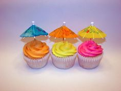 Tropical Cupcakes - These cupcakes were done for a birthday party with a tropical theme. Umbrellas are the cheap drink favours found at most party stores.