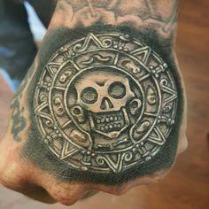 Hand tattoo. Pirate coin.