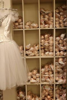 "My first ballet teacher had shelves full of pointe shoes, too! I was so fascinated by them that I briefly ""borrowed"" a pair, but don't worry. I returned them unharmed. :)"