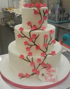 3-tier cake with pink cherry blossoms