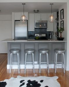 See the taller, narrower European style refrigerator! A must have for our new loft condo.