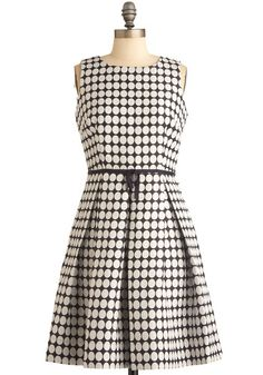 This dress would look so adorable with a black cardi, white knee socks, and black patent pumps!