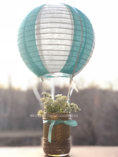 Hot air balloon themed birthday party centerpiece, assembly required but super easy, adventure themed babyshower, chalk gold mason jar Balloon Topiary, Hot Air Balloon Centerpieces, Diy Hot Air Balloons, Birthday Party Centerpieces, Diy Baby Shower Decorations, Baby Shower Centerpieces, Wedding Balloons, Baby Shower Balloons, Easy Adventure