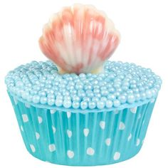 Perfect for pool parties or under the sea birthdays, these cupcakes are topped with seashells molded with Candy Melts® Candy and Wilton Seashells Candy Mold.