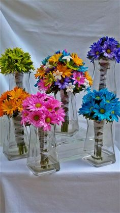 Crazy Daisy Bouquets, the multi colored one for the bride and a different color for each of the bridesmaids?